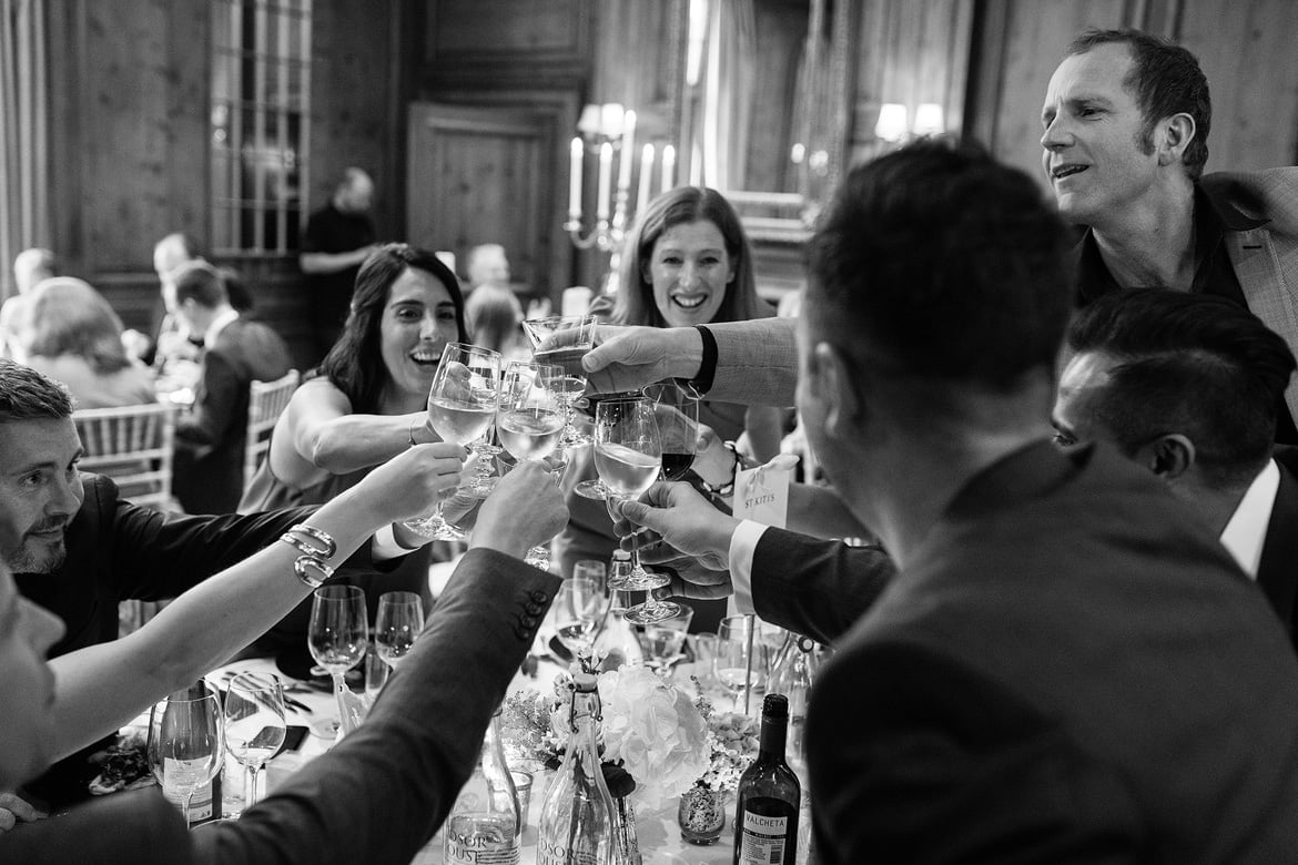 guests raise a toast at hedsor house