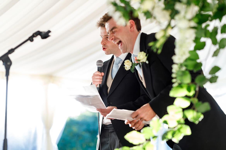 best men laugh at their own speech