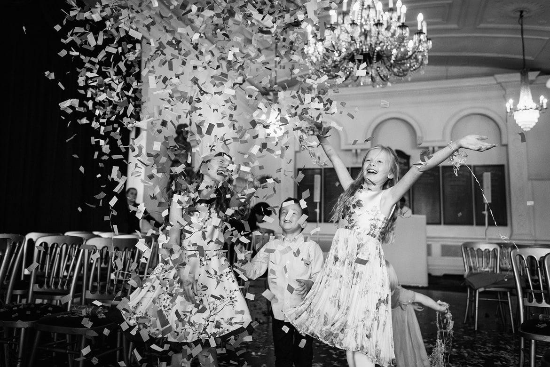 children throw confetti at a trafalgar tavern wedding