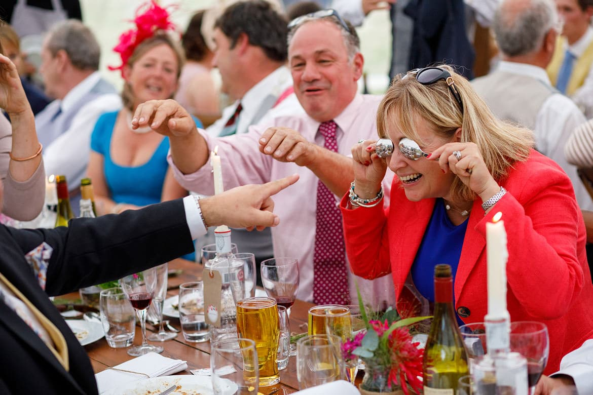 wedding guests fooling around with spoons