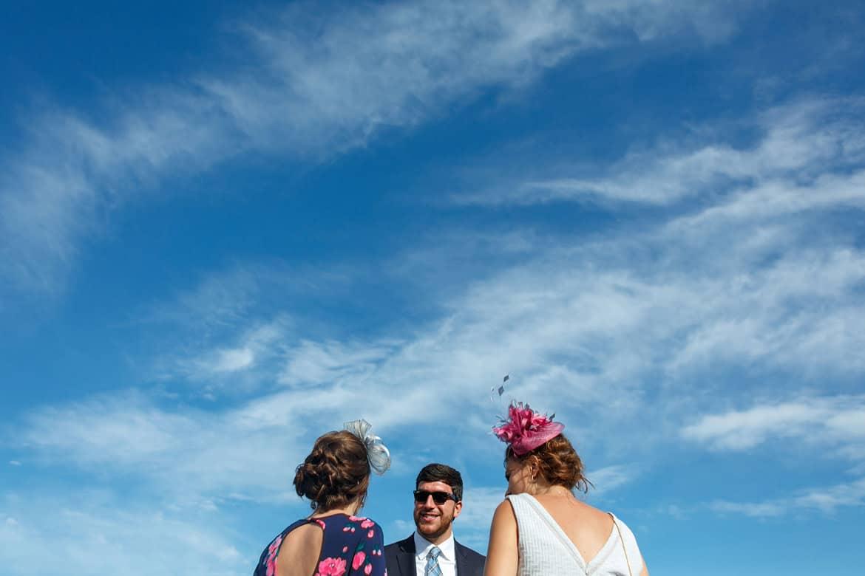 wedding guests under a summer sky