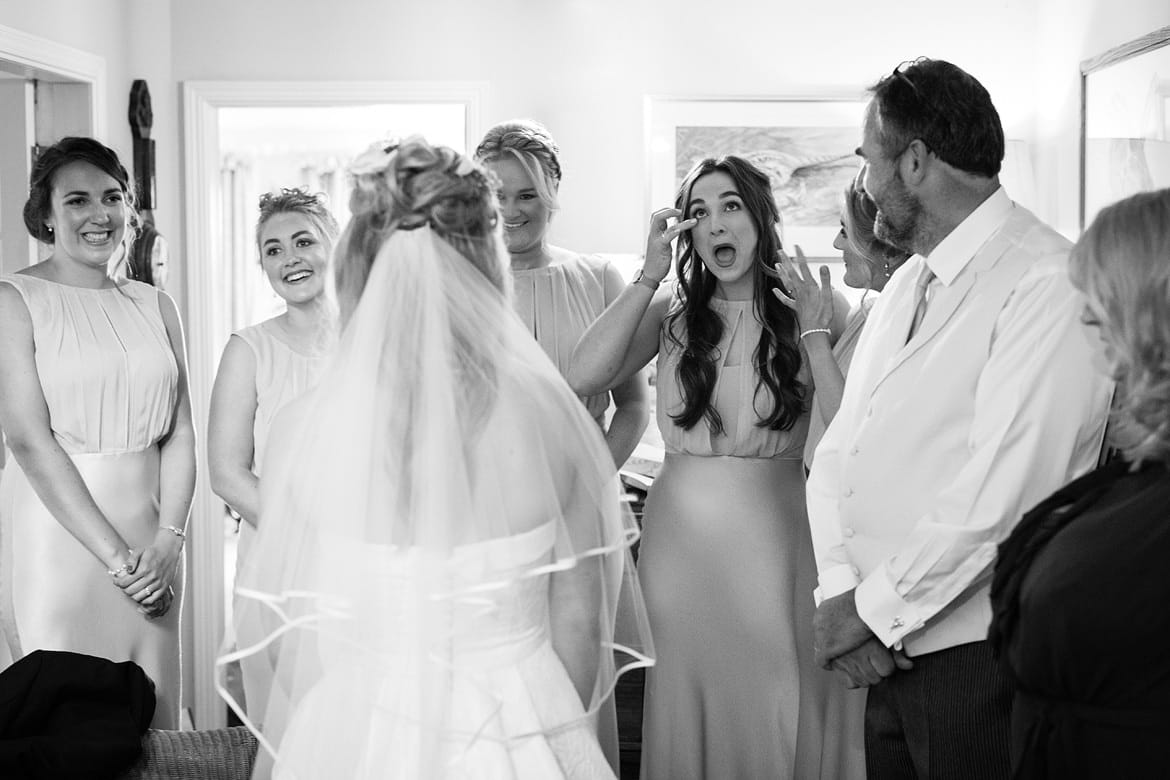 a bridemaid tears up on seeing the bride in her dress