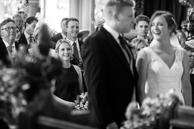 a bridesmaid looks on in aldeburgh church