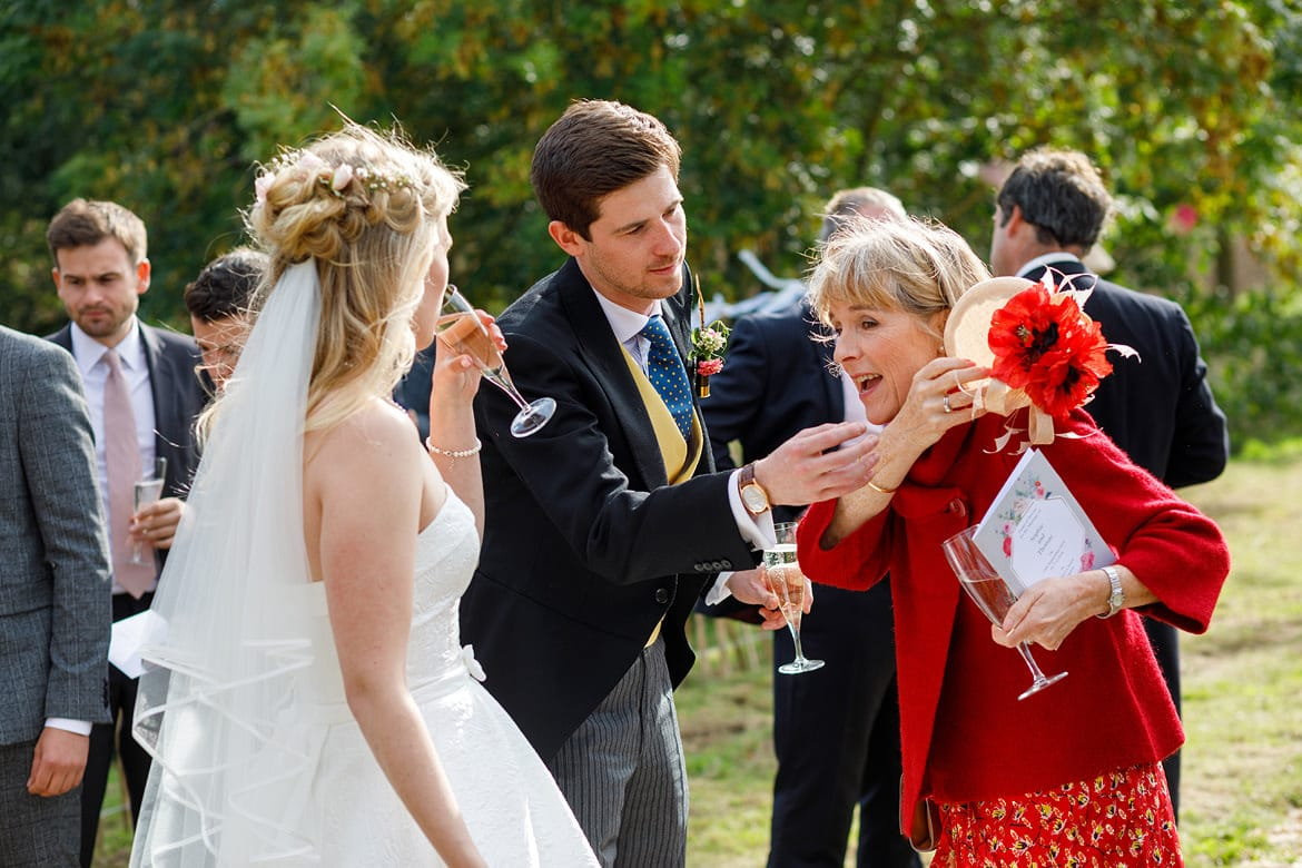 the groom lends a hand at a suffolk marquee wedding