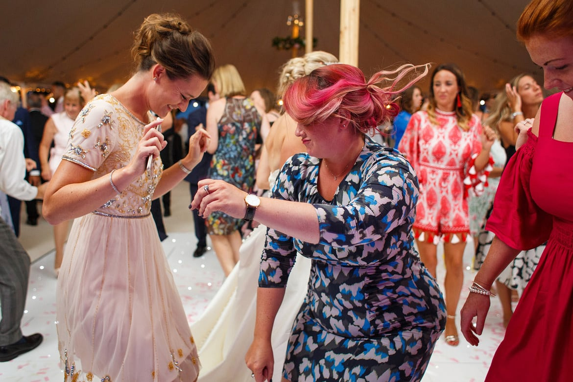 guests dancing at a marquee wedding