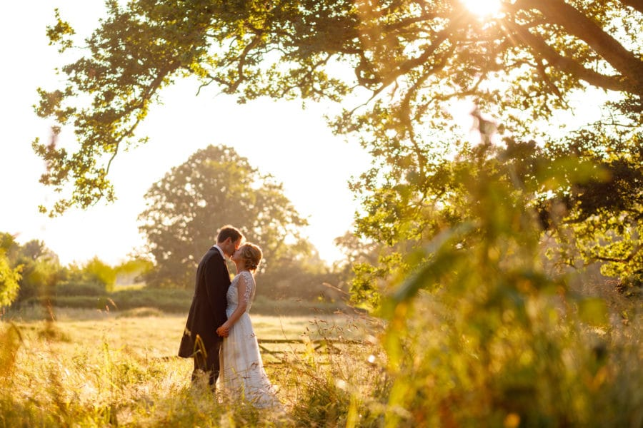 bride and groom in the fields at pennard house