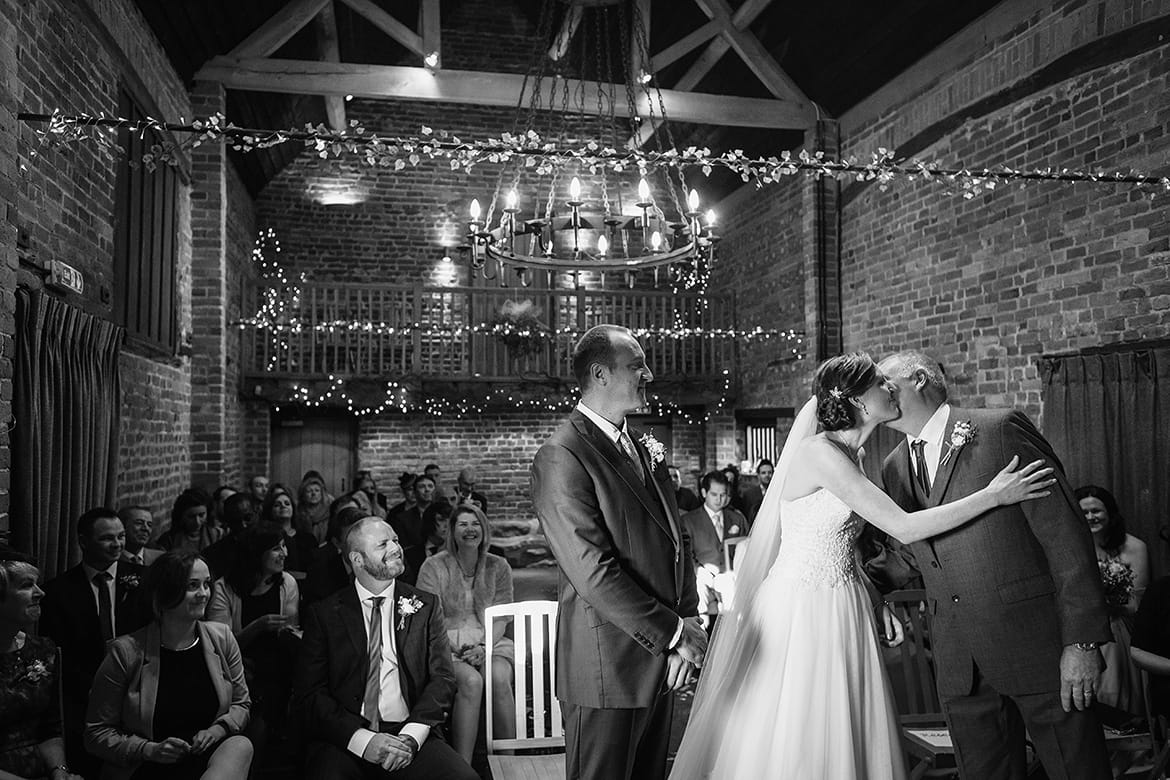 the bride kisses her father at a curradine barn wedding