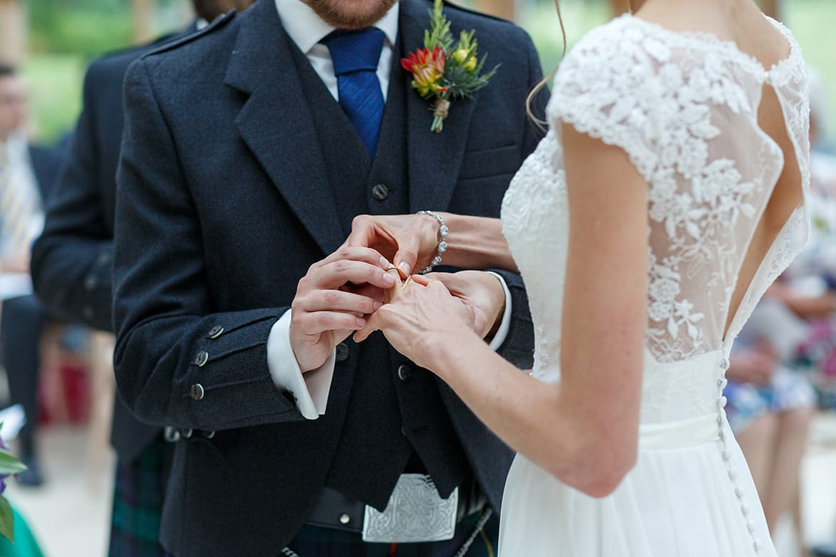 exchanging rings at a gaynes park wedding