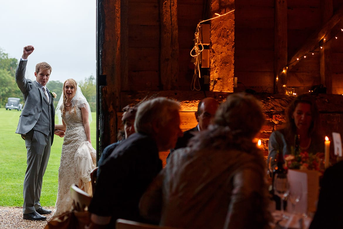 bride and groom look in their suffolk barn wedding reception