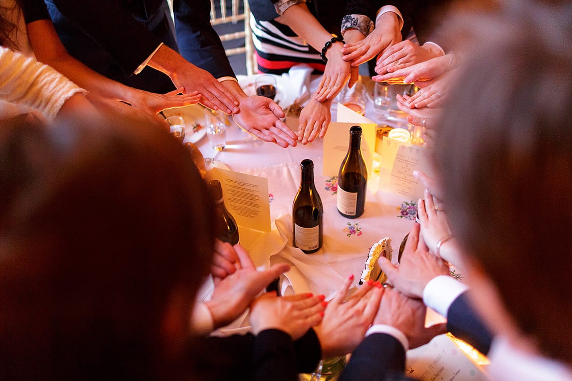 guests form a ring with their hands