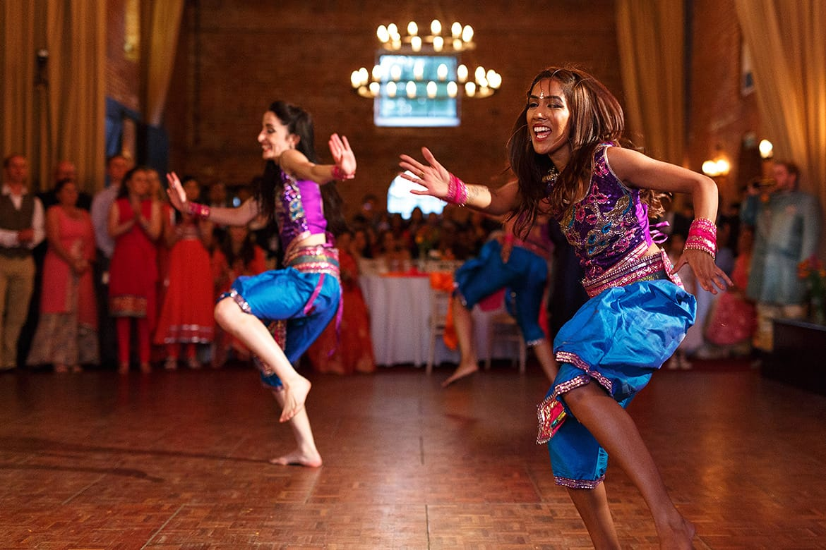 indian dancers at a sussex barn wedding