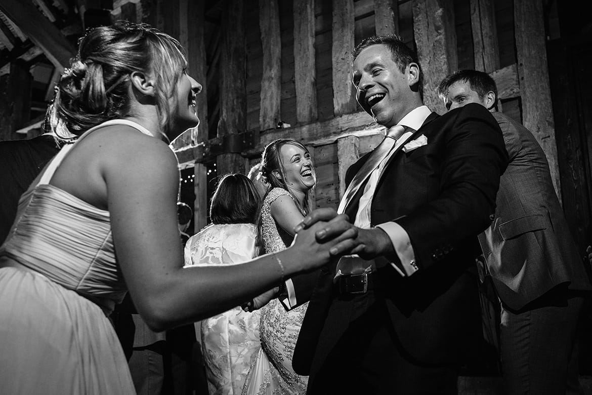 guests dancing at a suffolk barn wedding