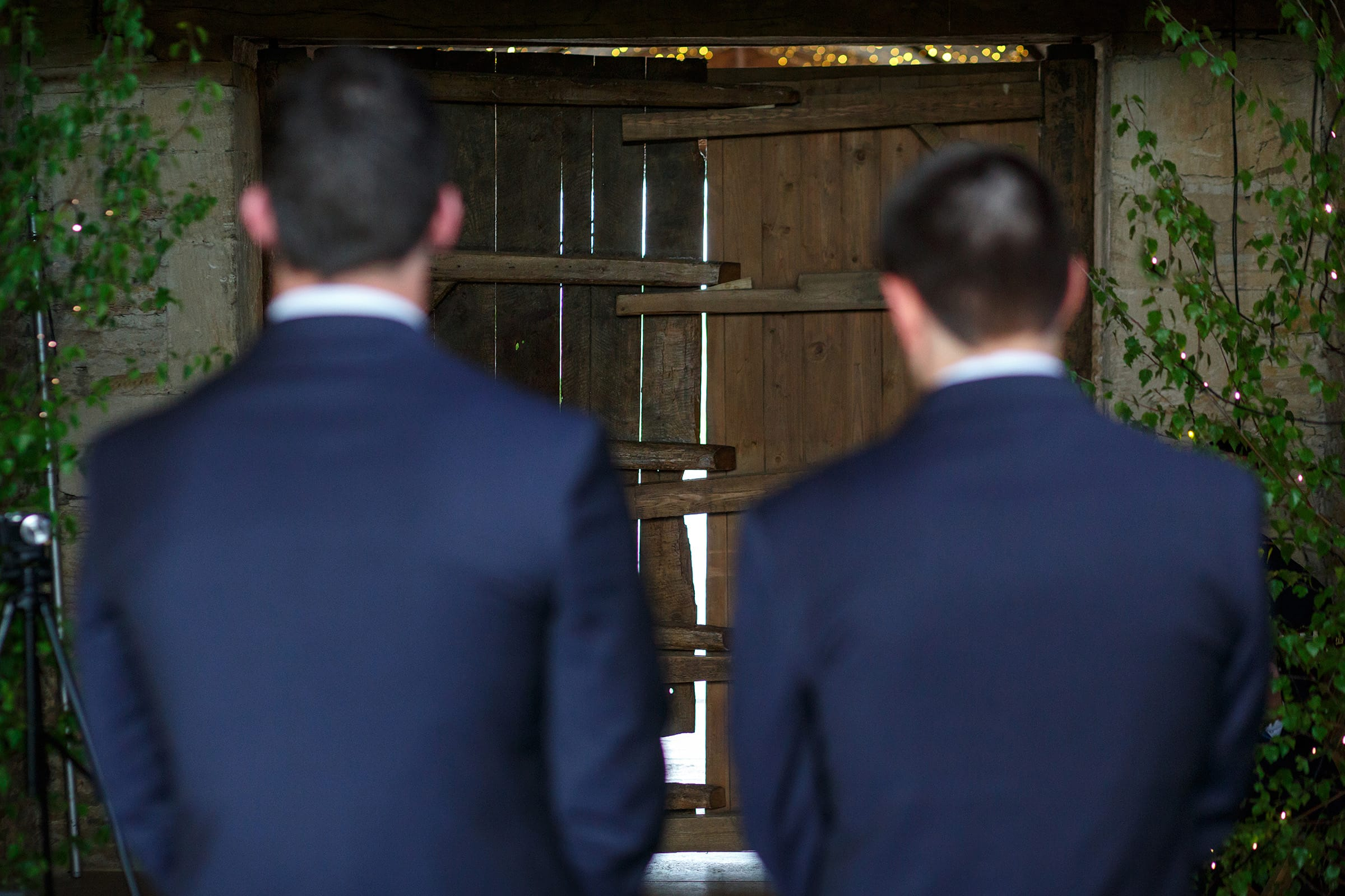 groom and best man waiting for the bride at cripps stone barn