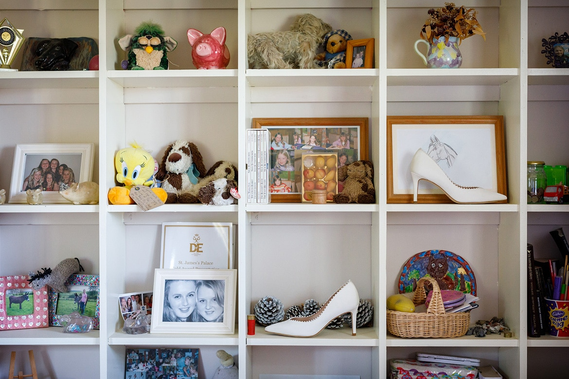 wedding shoes on the shelves in the brides bedroom