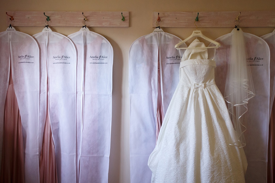 wedding dress detail photo with the bridesmaid dresses