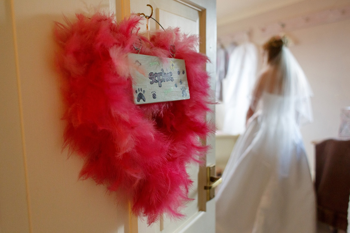 the brides name in feathers on her bedroom door