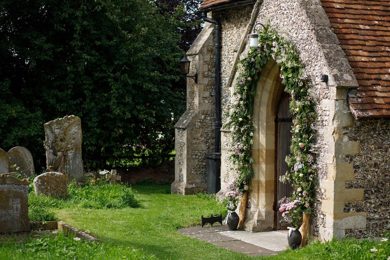 a flower arch around a church doorway