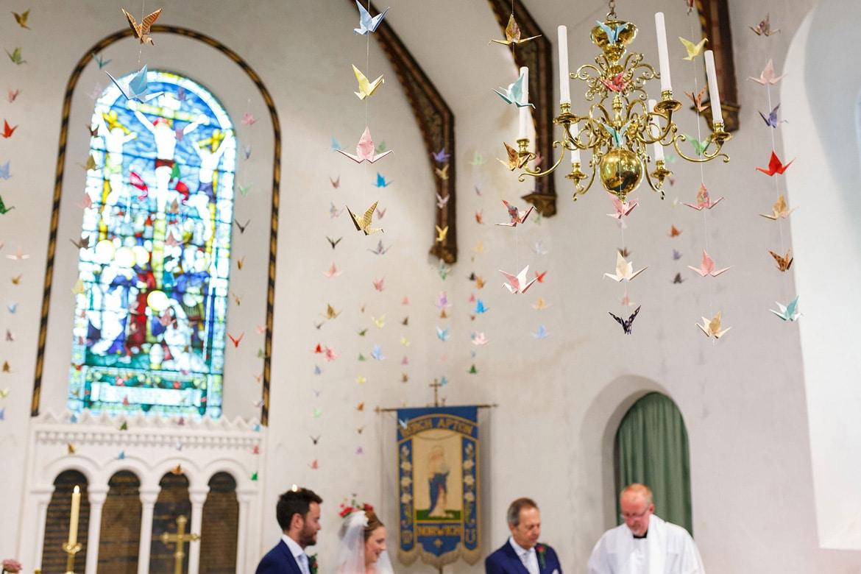 Senbazuru origami cranes hang in church