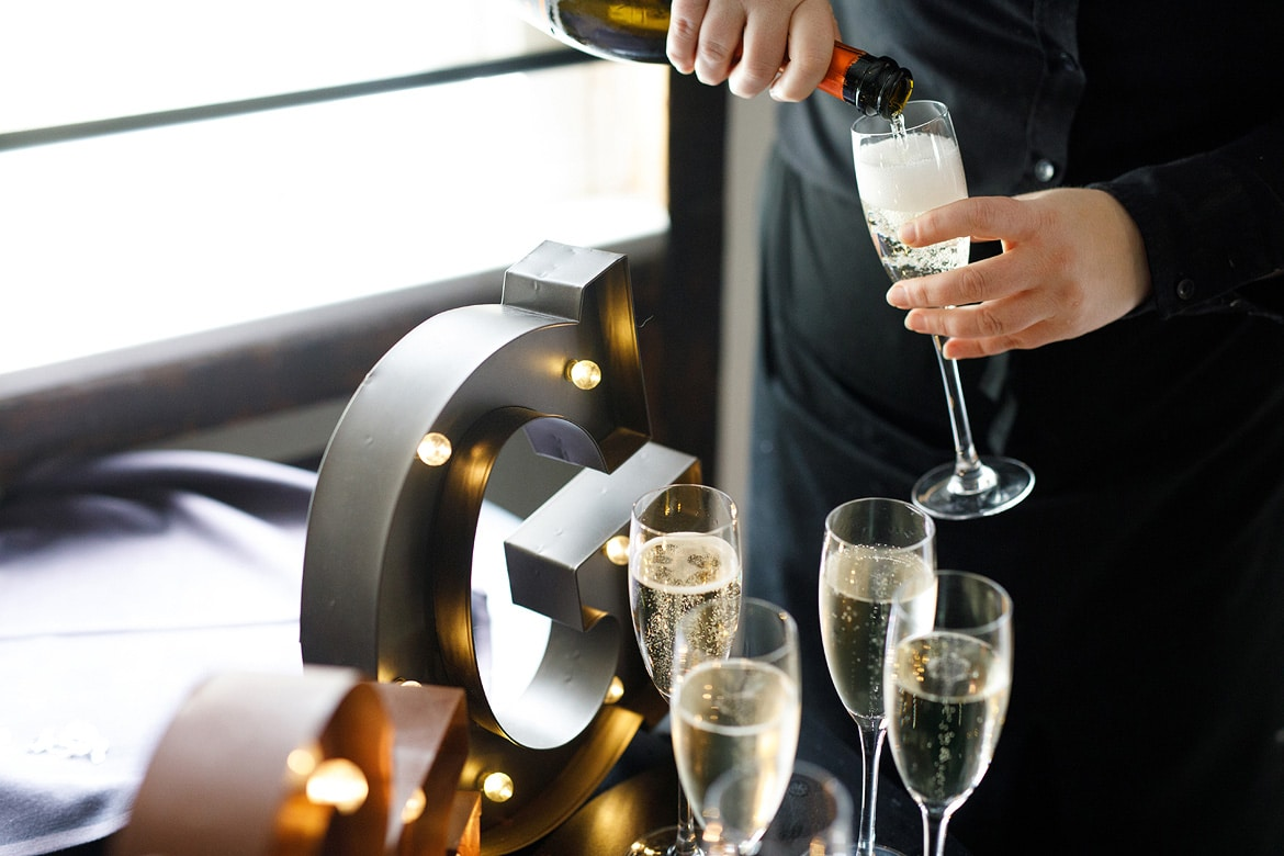 pouring champagne before the speeches