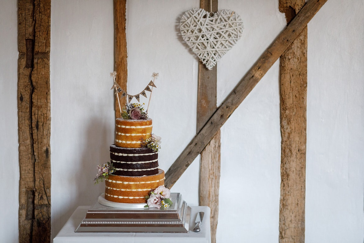 a naked wedding cake at a maidens barn wedding