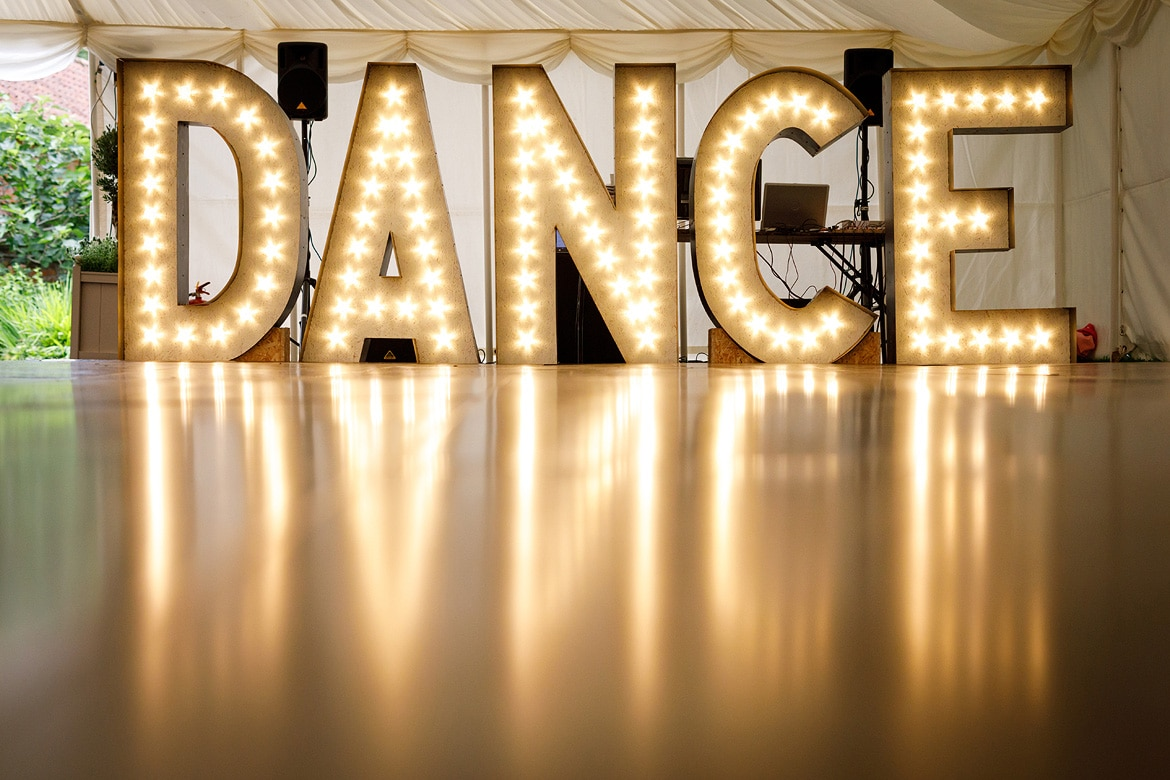 huge dance sign made by the groom