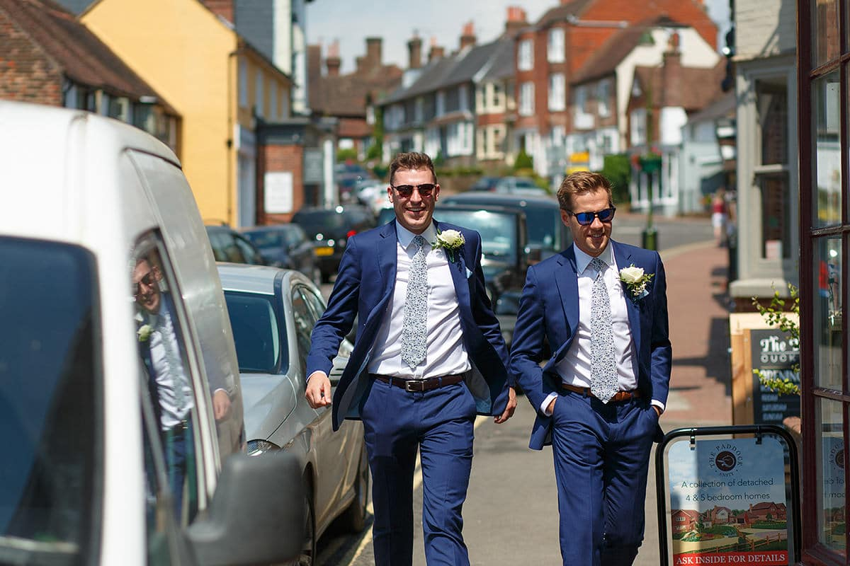 two ushers walk through cuckfield