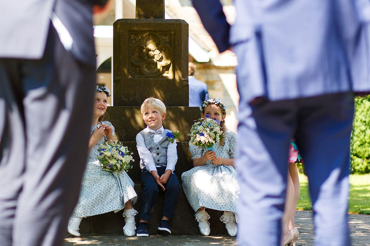 page boys and flower girls outside the church