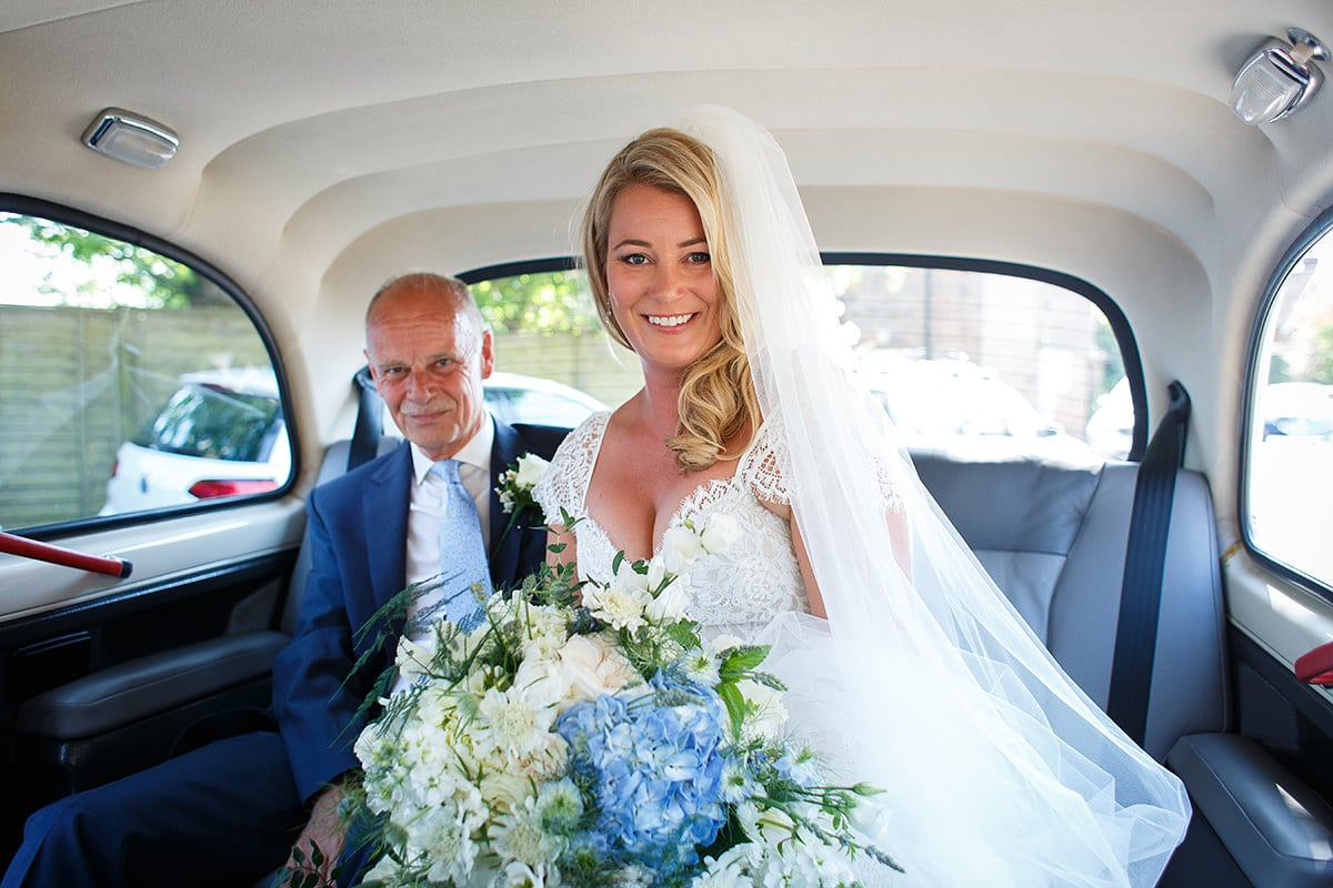 the bride with her father in the taxi