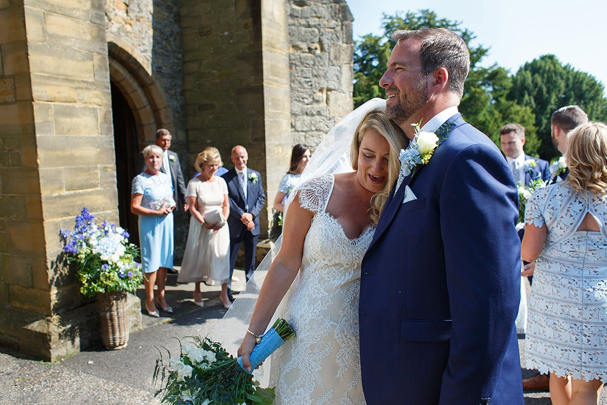 bride and groom outside cuckfield church