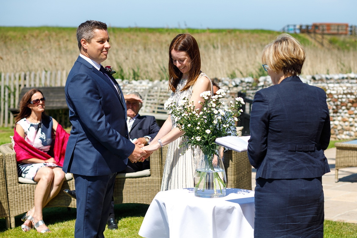 a wedding ceremony on the north norfolk coast