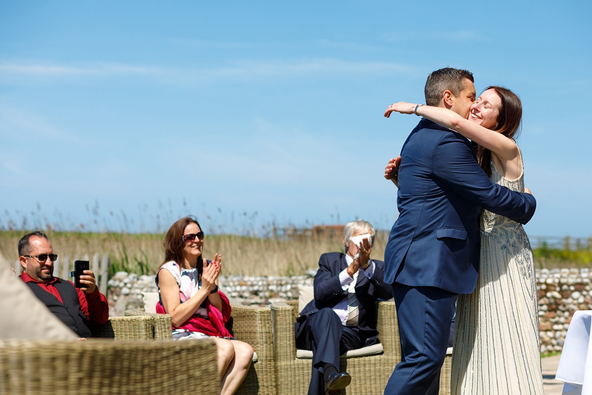 hugs at their outdoor wedding