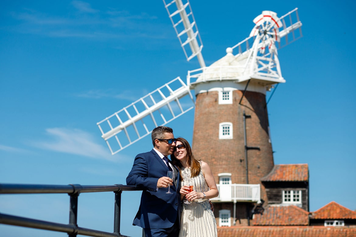 wedding portrait in the sunshine in front of cley mill
