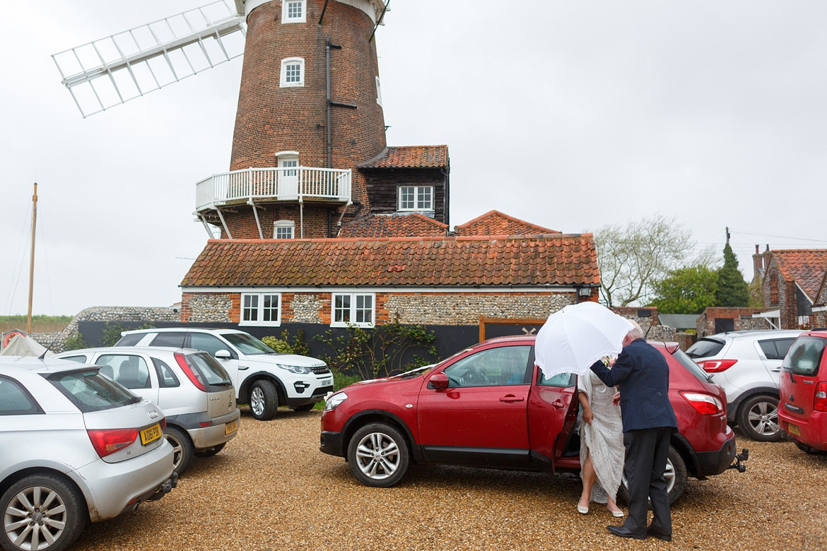 a bride arrives at cley mill