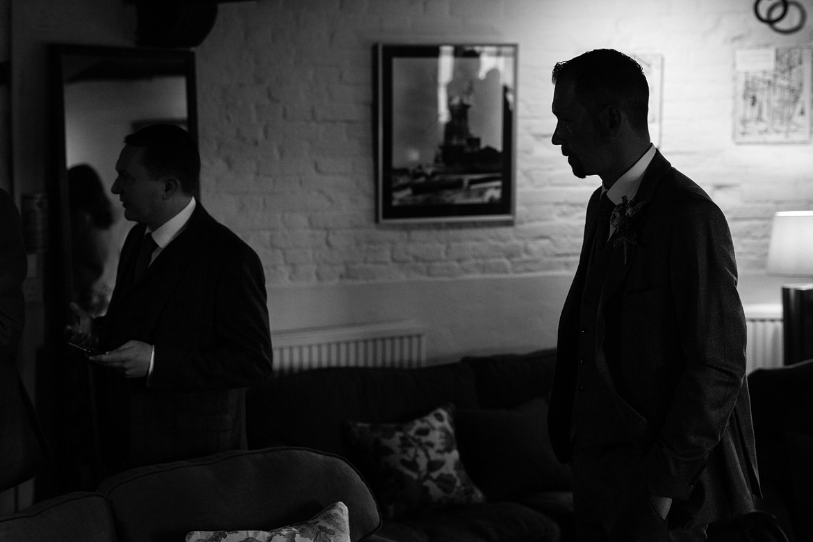 the groom waits in the ceremony room at cley windmill