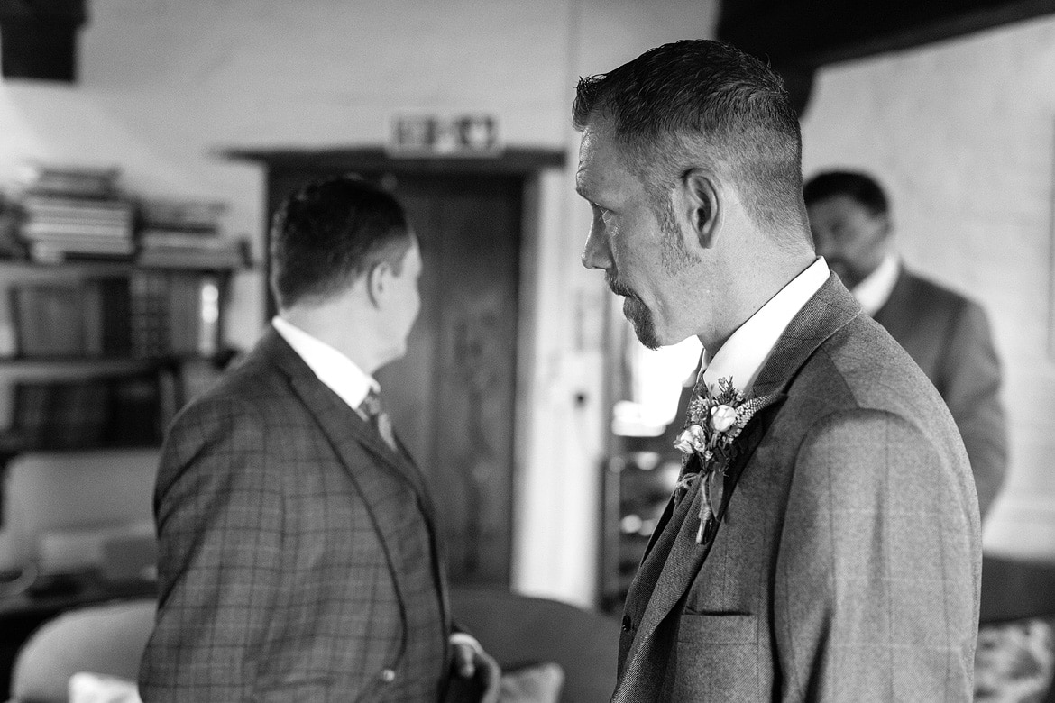 simon waits for alice at their cley mill wedding
