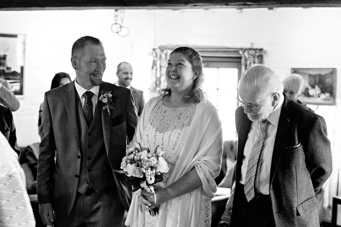 alice and simon laugh in the cley windmill ceremony room