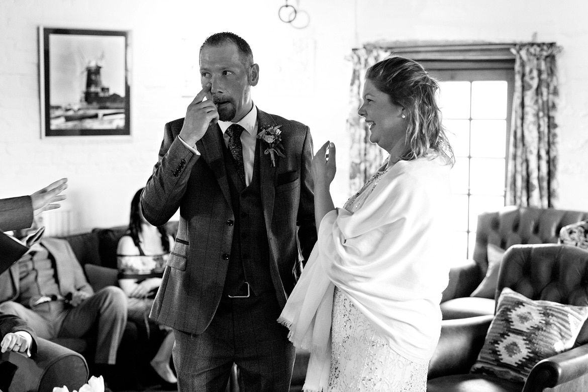 a brief tear during a cley windmill wedding