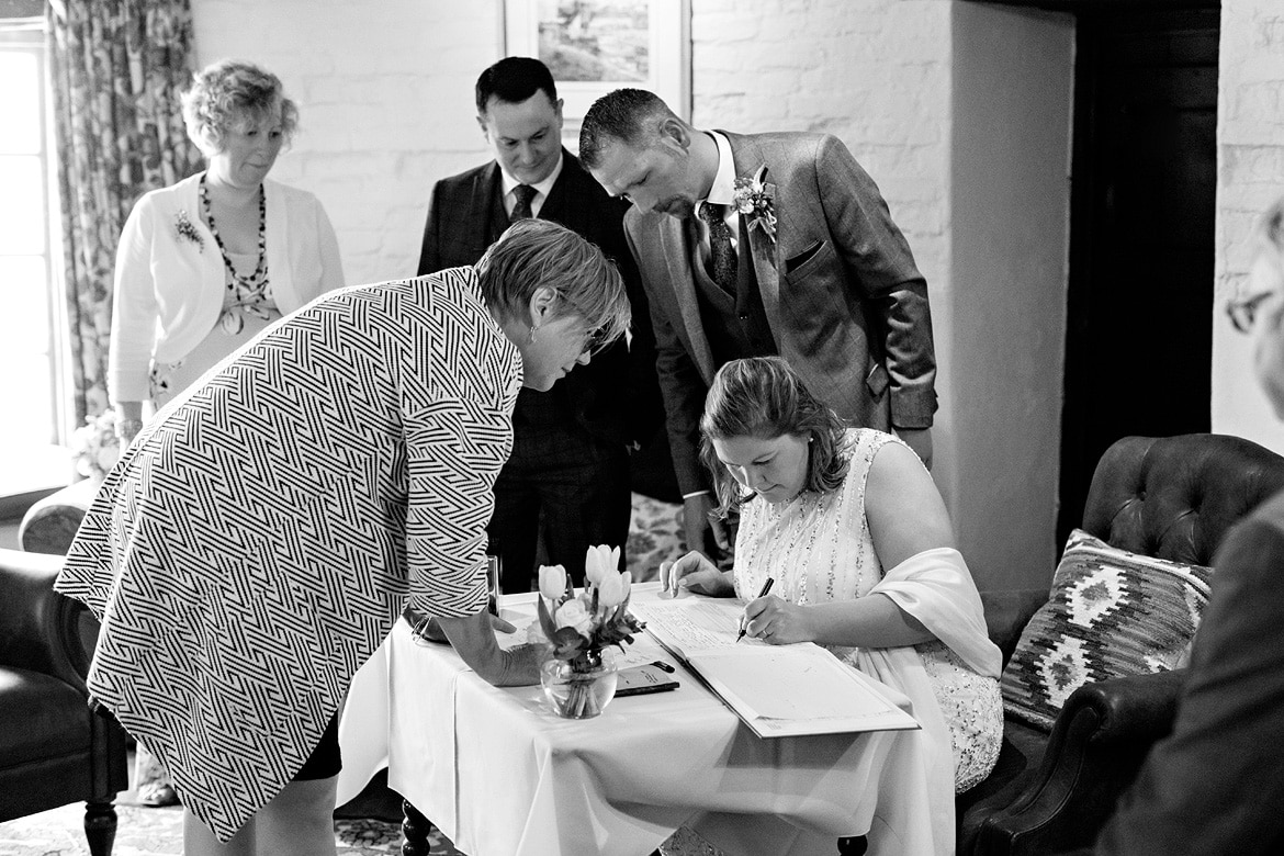 signing the register at a north norfolk wedding