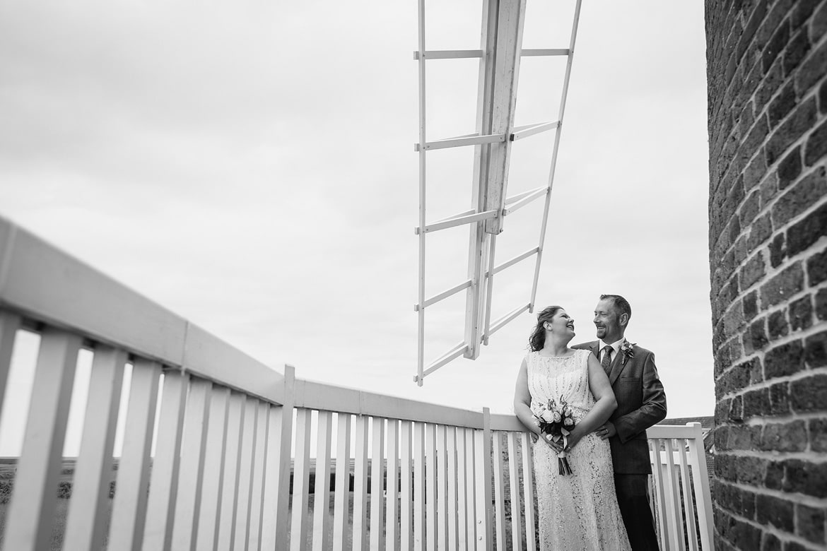 bride and groom on the balcony of cley windmill