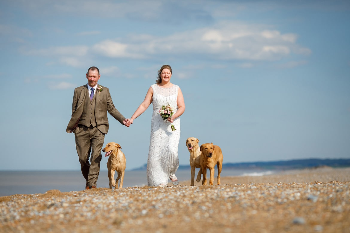 bride and groom on the beach at cley next the sea