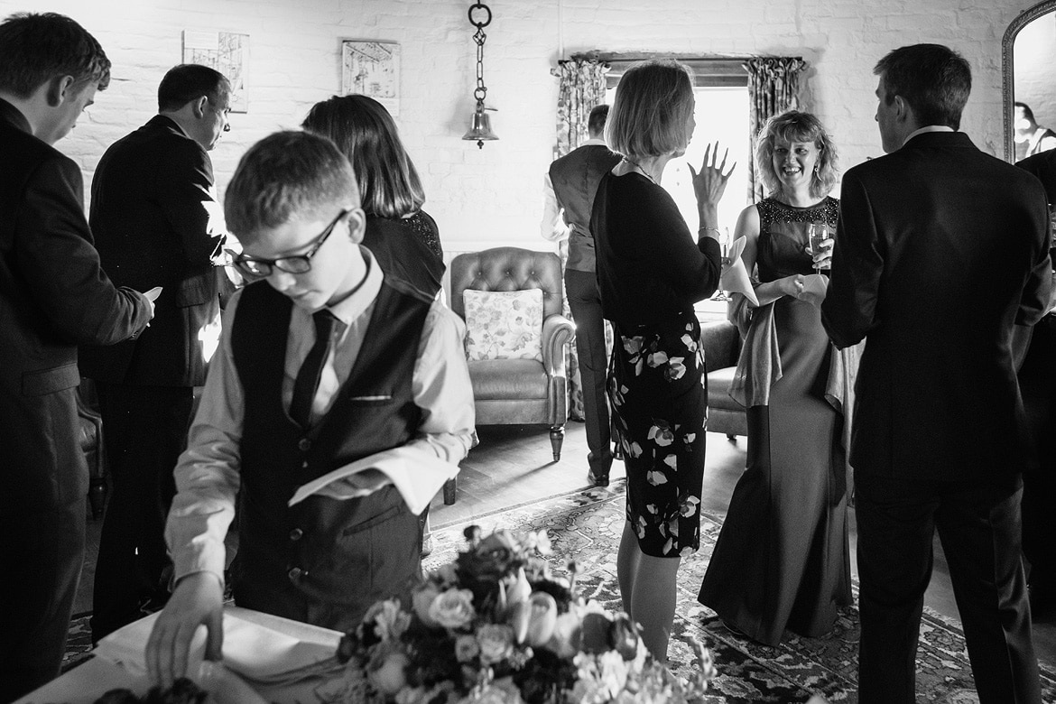 the bride laughs with guests at a cley windmill wedding
