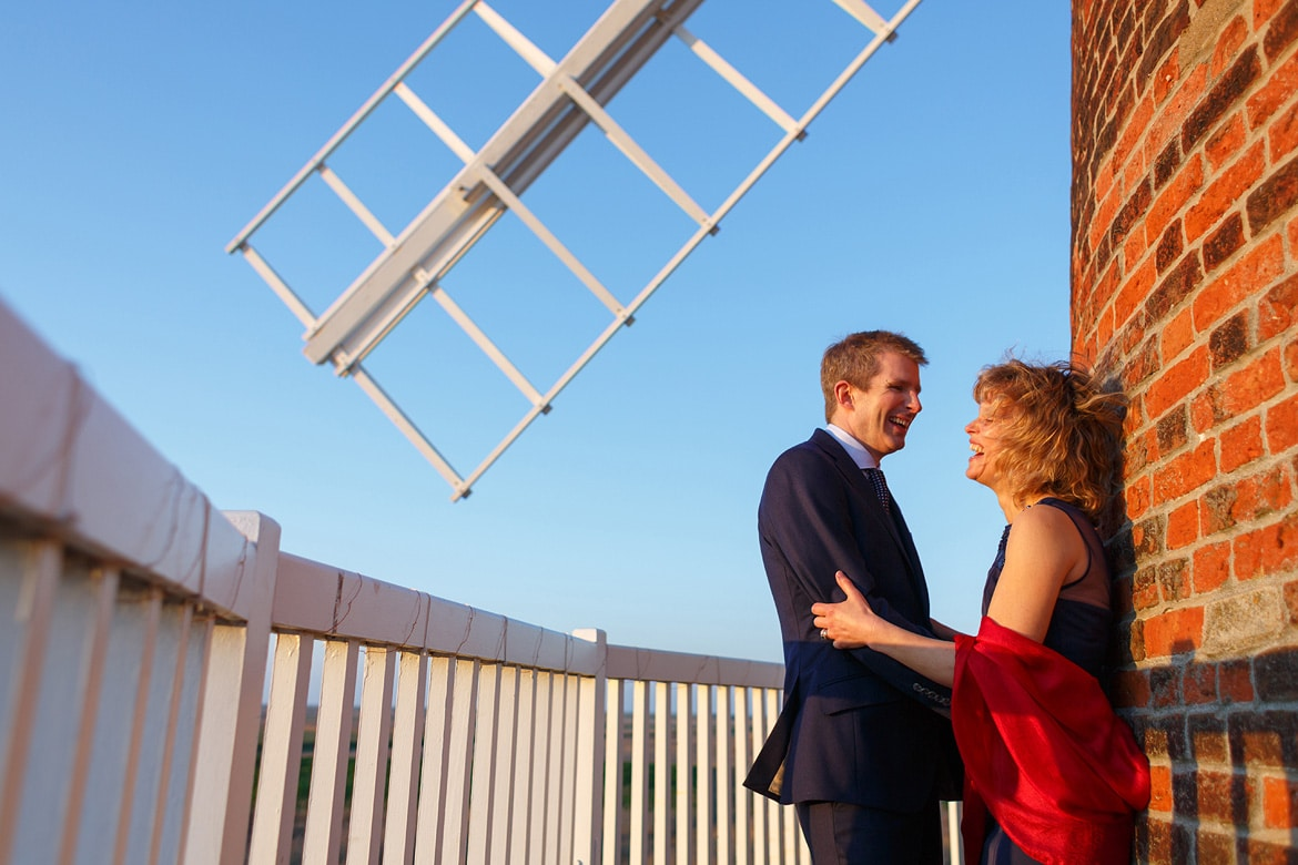 the bride and groom on the balcony of cley windmill