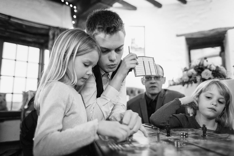 the kids play cluedo