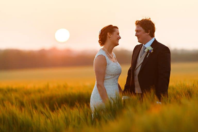 sunset couple photo in a norfolk field
