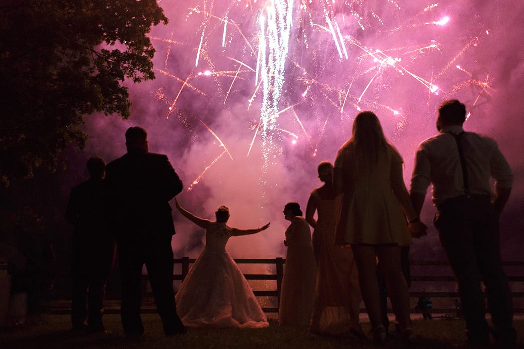 bride dancing with fireworks