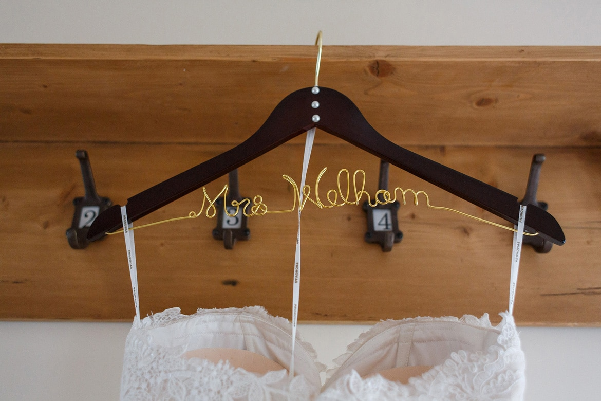 coat hanger for the wedding dress with the brides name on it