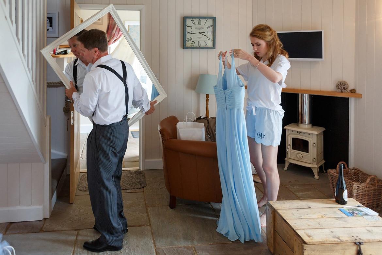 a bridesmaid prepares her dress