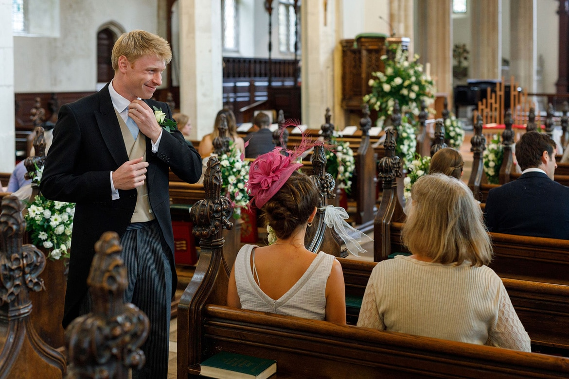 the groom greets guests in framlingham church