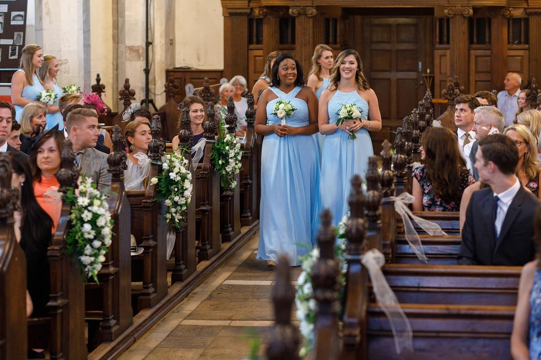 the bridesmaids walk down the aisle
