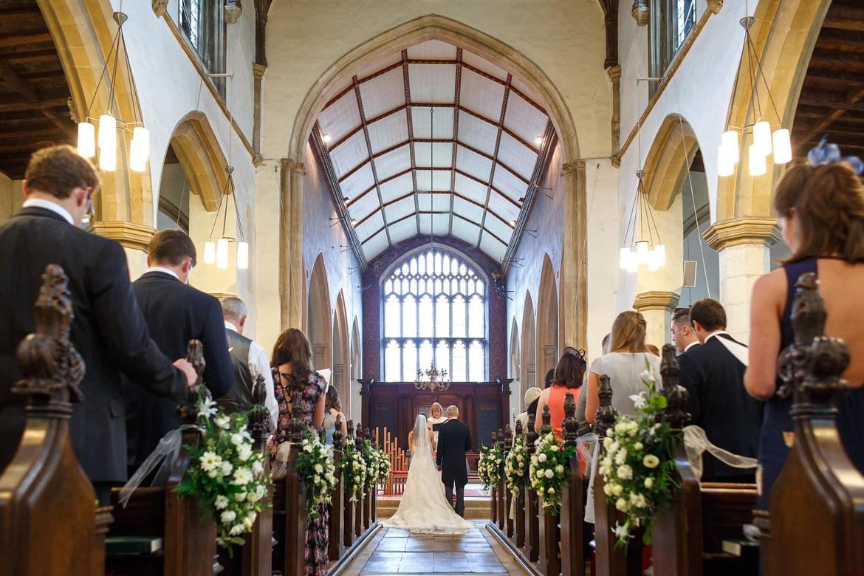 a framlingham church wedding shot from the rear